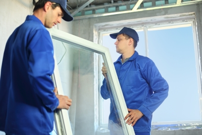 two-men-carrying-window-frame